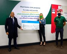 Michael Patel giving Morrisons a cheque for their food banks.