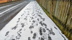 Footprints in icy snow in Preston Pic: Tony Worrall