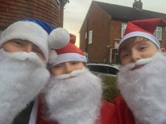 Ian Watkinson with his sons Harry and Jackson did their Santa Dash in Penwortham on Christmas Day