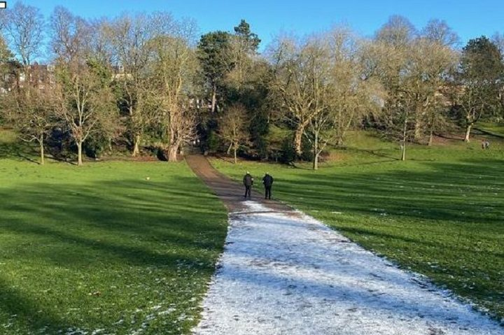 Two Covid marshals seen walking across Avenham Park following the incident Pic: Lauren Melling