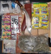 Drugs and knives seized by police during the incident in Fletcher Road Pic: Preston Police