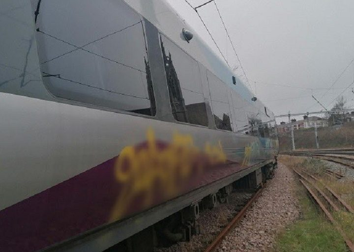 Police blurred the graffiti to ensure those responsible don't take the 'kudos' from the incident Pic: British Transport Police
