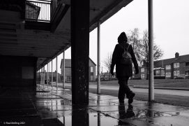 A damp day in Preston as passer-by walks by the Savick shops Pic: Paul Melling