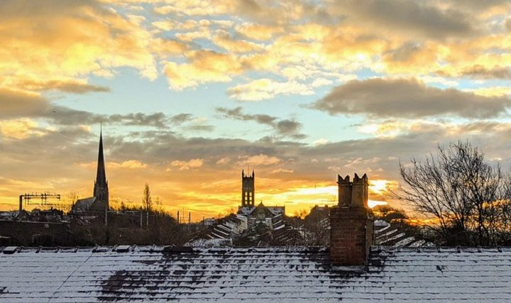 Sunrise over snowy rooftops in Preston Pic: Tony Worrall