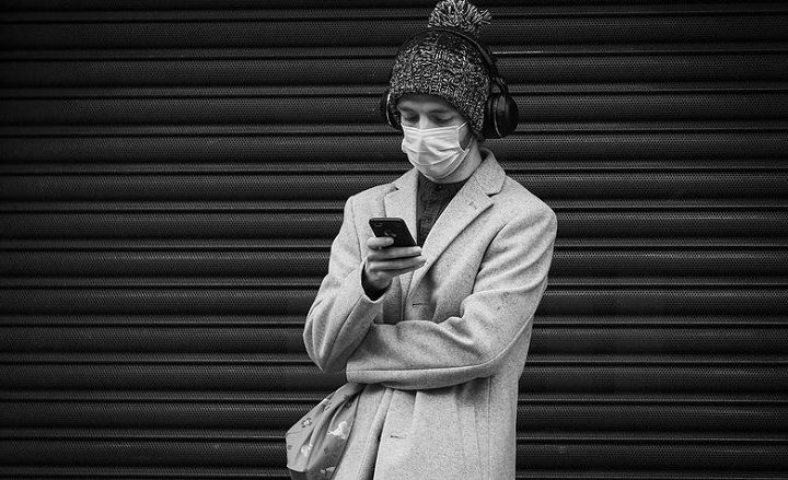 Wearing a face mask in Preston city centre during a phone check Pic: Paul Melling