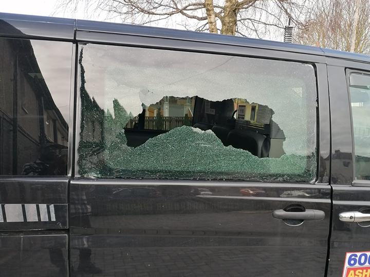 Ashton Allied taxi smashed window