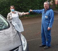 Bev Stevenson from Caritas Care and Carl Kramer from Kramer Motors Pic: Caritas Care
