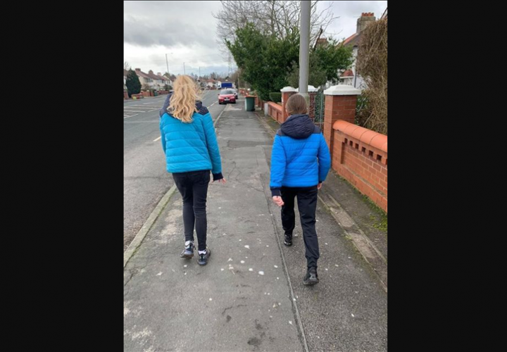Two of the girls on their walk to raise money.