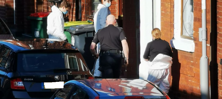 Police pictured entering a property in Arkwright Road Pic: Crispin Robinson