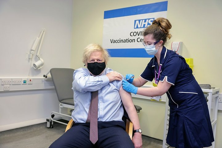 Boris Johnson receives his first coronavirus vaccine Pic: Downing Street