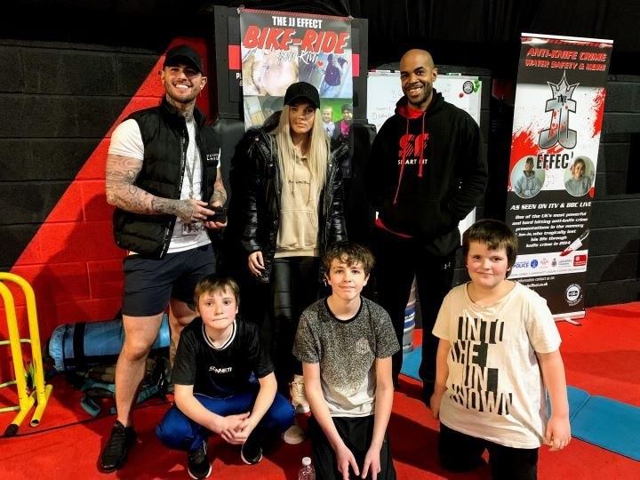 Byron, Dan and Kim Fletcher with children from the JJ Effect youth group.