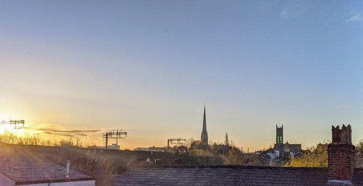 Sunrise over Preston rooftops with St Walburge's spire in view Pic: Tony Worrall