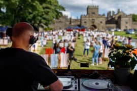 DJ looking out at a Crafty Vintage crowd at Hoghton Tower