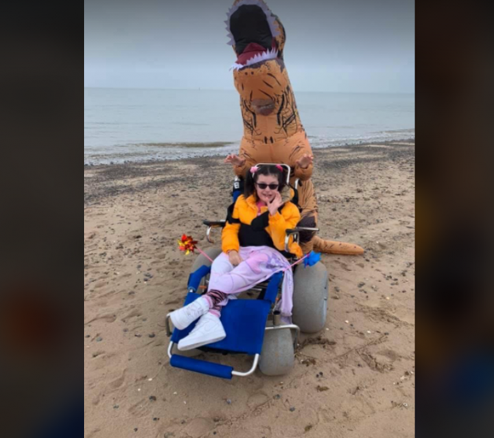 Alice with her mum Lindsay dressed as a dinosaur whilst doing their 60-miles.
