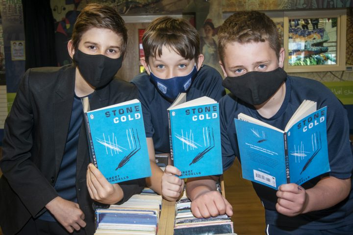 Students reading Stone Cold to suppose the Rise and Shine Charity.