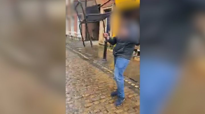 The man is seen holding the chair before charging at people sat at a table outside Forum bar in Winckley Street Pic: Blog Preston