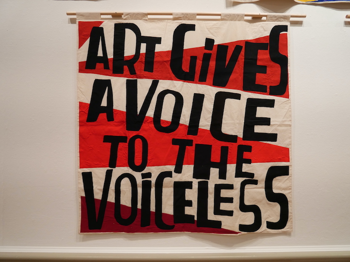Art Gives a Voice to the Voiceless - Fabric banner by Elizabeth Cake, emblazoned with text by Bob and Roberta Smith Pic: Lisa Brown