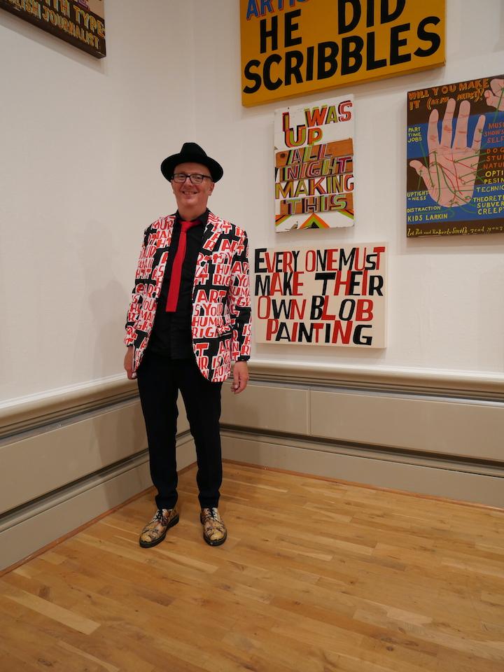 Bob and Roberta Smith alonside some of his artwork encouraging people to make art Pic: Lisa Brown