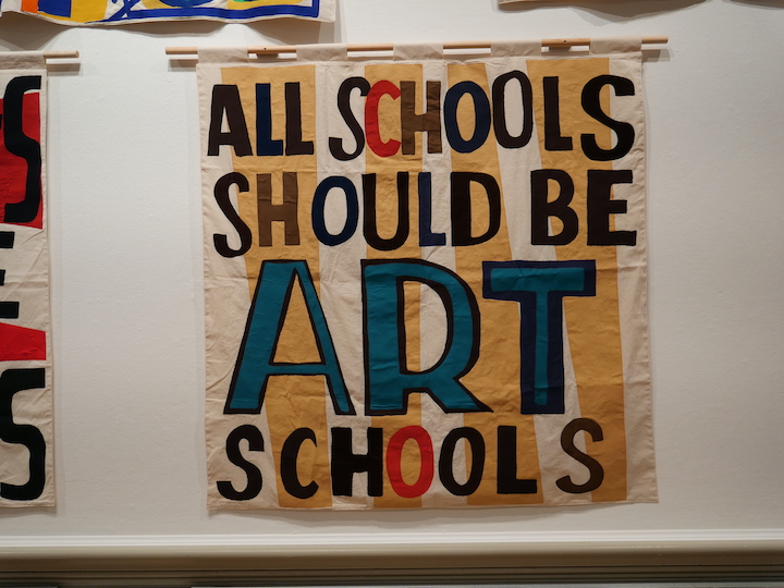 Large fabric banner made by Elizabeth Cake and emblazoned with text by Bob and Roberta Smith Pic: Lisa Brown