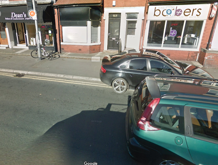 Car parked on the pavement outside Dean's Bakery