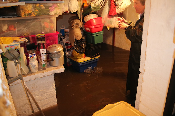 Knee-high water in one cottage cellar