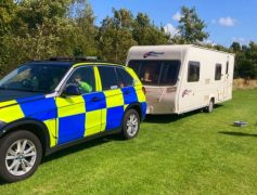 Police tow away one of the suspected stolen caravans Pic: Preston Police