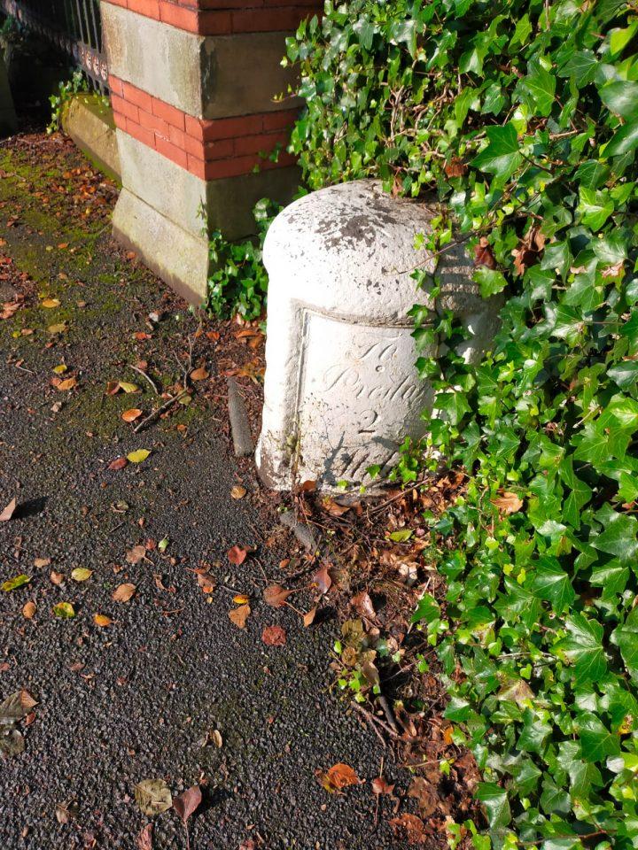 Grade II listed marker stone outside Harris Park.