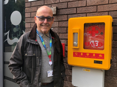 Councillor Mick Titherington with one of the new defibrillators Pic: South Ribble Borough Council